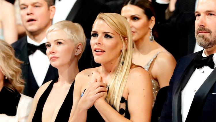 Busy Philipps clutches her perfectly manicured nails as the 'Moonlight' cast and crew give their thank-you speech. (Al Seib / Los Angeles Times)
