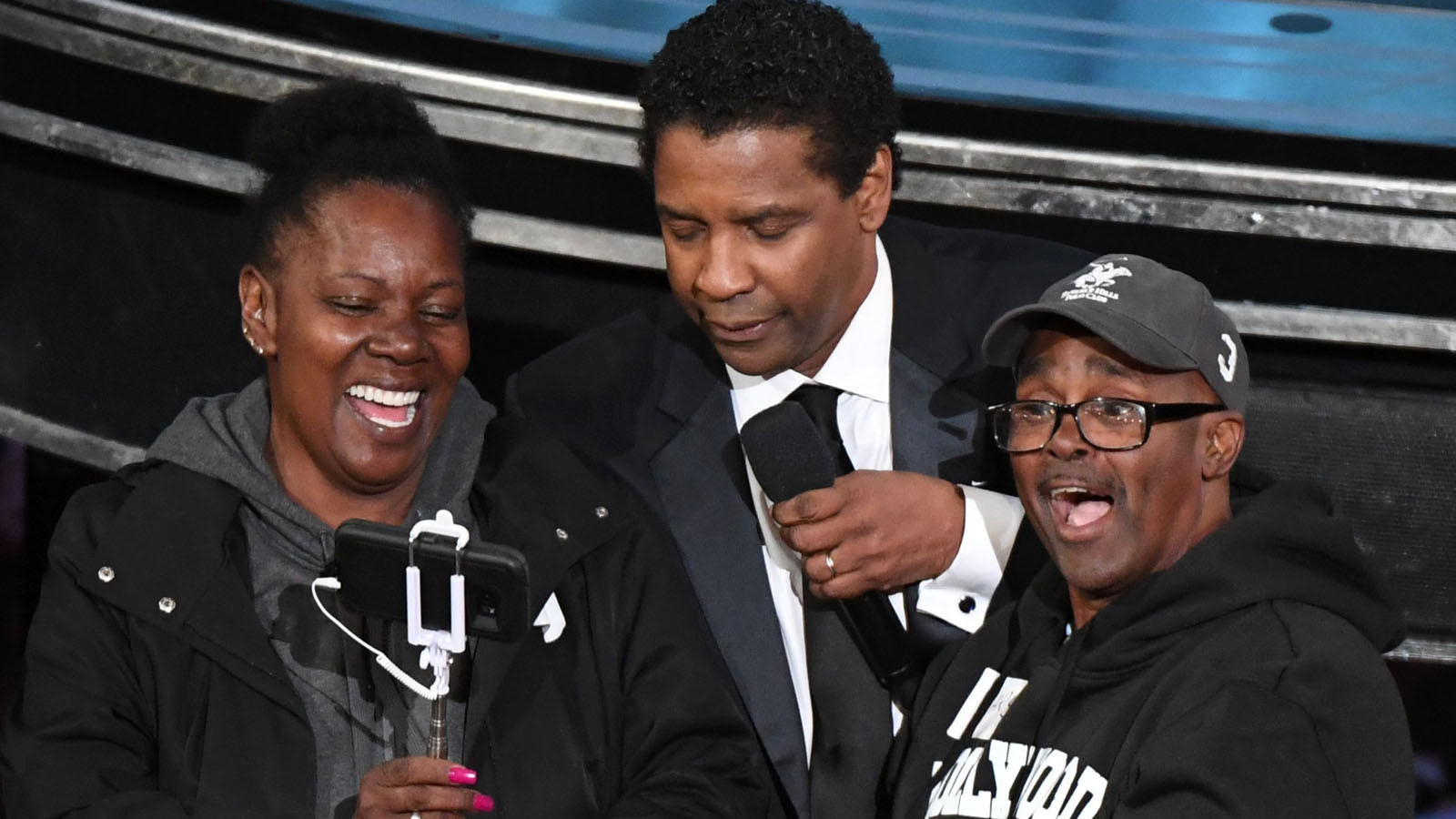 Vickie Vines, Denzel Washington and Gary Alan Coe at the Oscars on Sunday. (Mark Ralston / AFP / Getty Images)