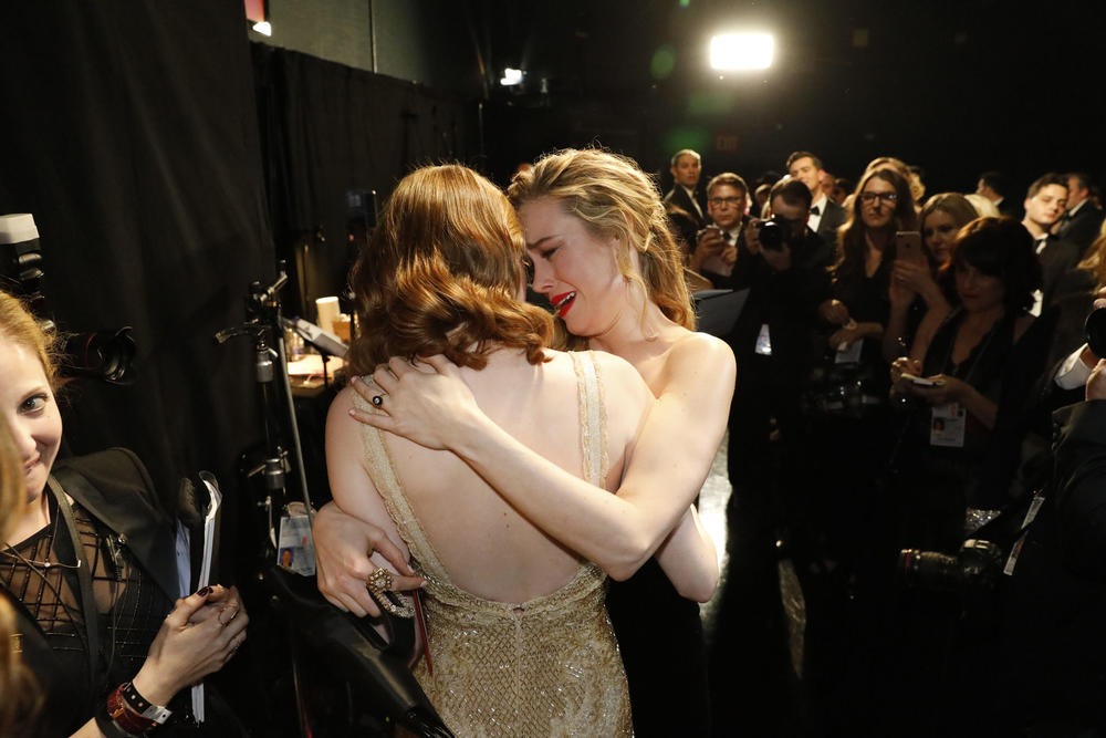 Brie Larson congratulates Emma Stone on her best actress win at the 89th Academy Awards. (Al Seib / Los Angeles Times)