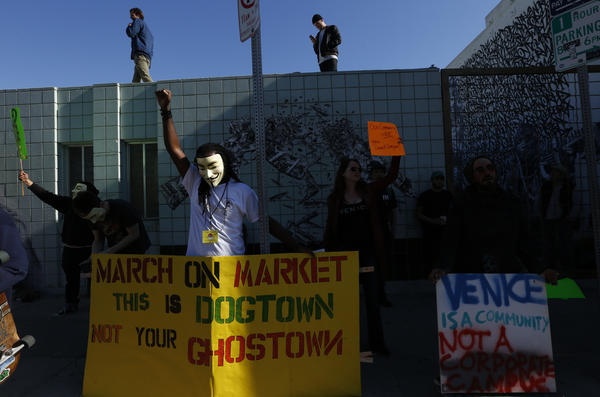 People frustrated by Snap's many offices in Venice protest on the block with buildings where the company's key executives work. (Genaro Molina / Los Angeles Times)
