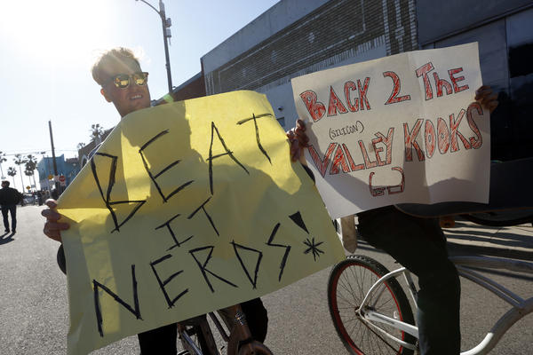 Tony Pettibone, left, was among demonstrators in Venice on Tuesday. (Genaro Molina / Los Angeles Times)