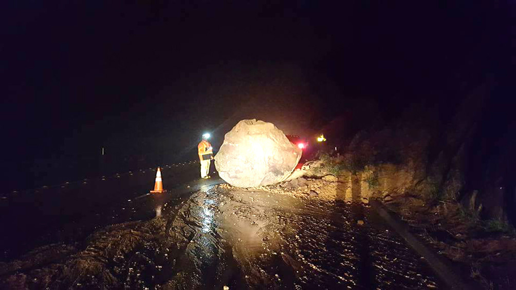 A photo posted on Facebook shows a boulder that slid onto state Route 67 near Cloudy Moon Drive Monday night. Crews worked to clear the roadway by the time of morning commute.