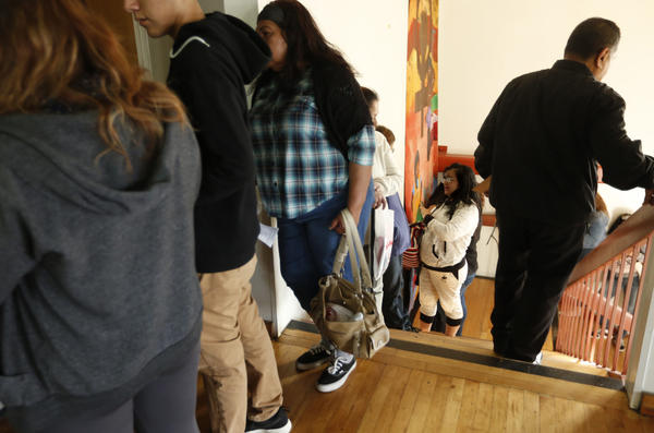 Immigrants wait in line on consultation day at the Central American Resource Center in Los Angeles. (Genaro Molina/Los Angeles Times)