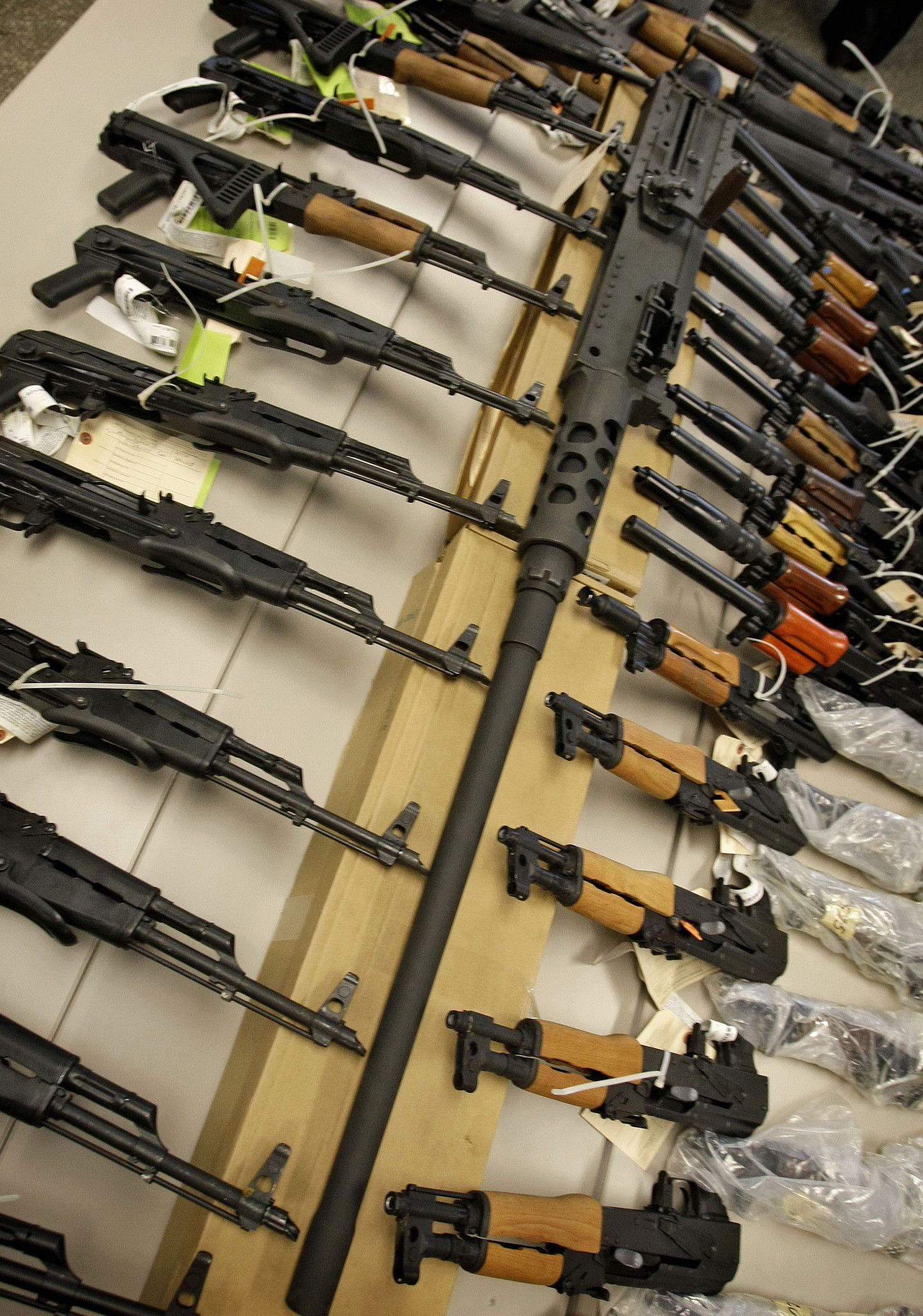 A cache of seized weapons displayed at a news conference in Phoenix. (Matt York / Associated Press)