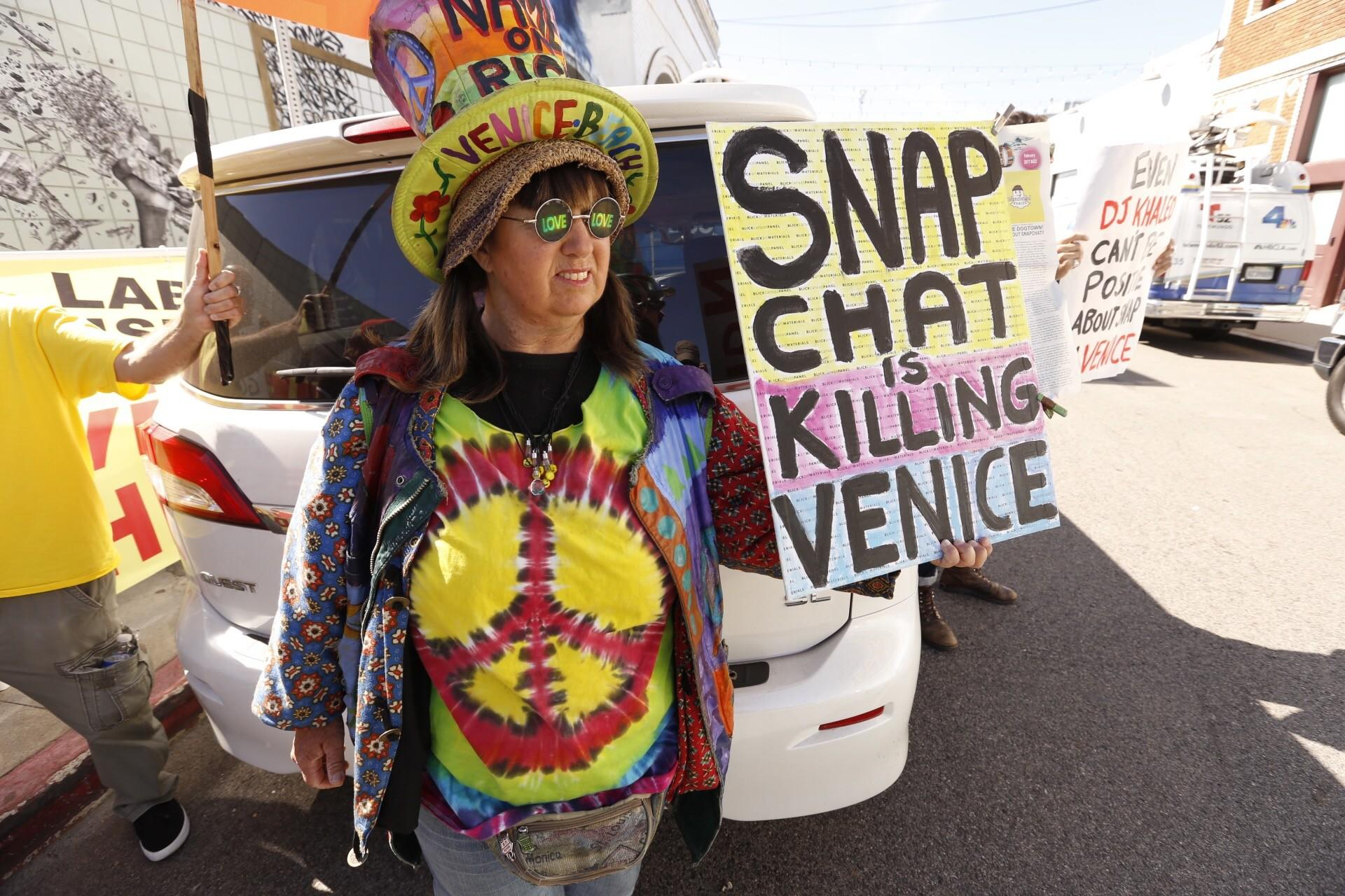 Vivianne Robinson protests near Snap's offices. (Al Seib / Los Angeles Times)