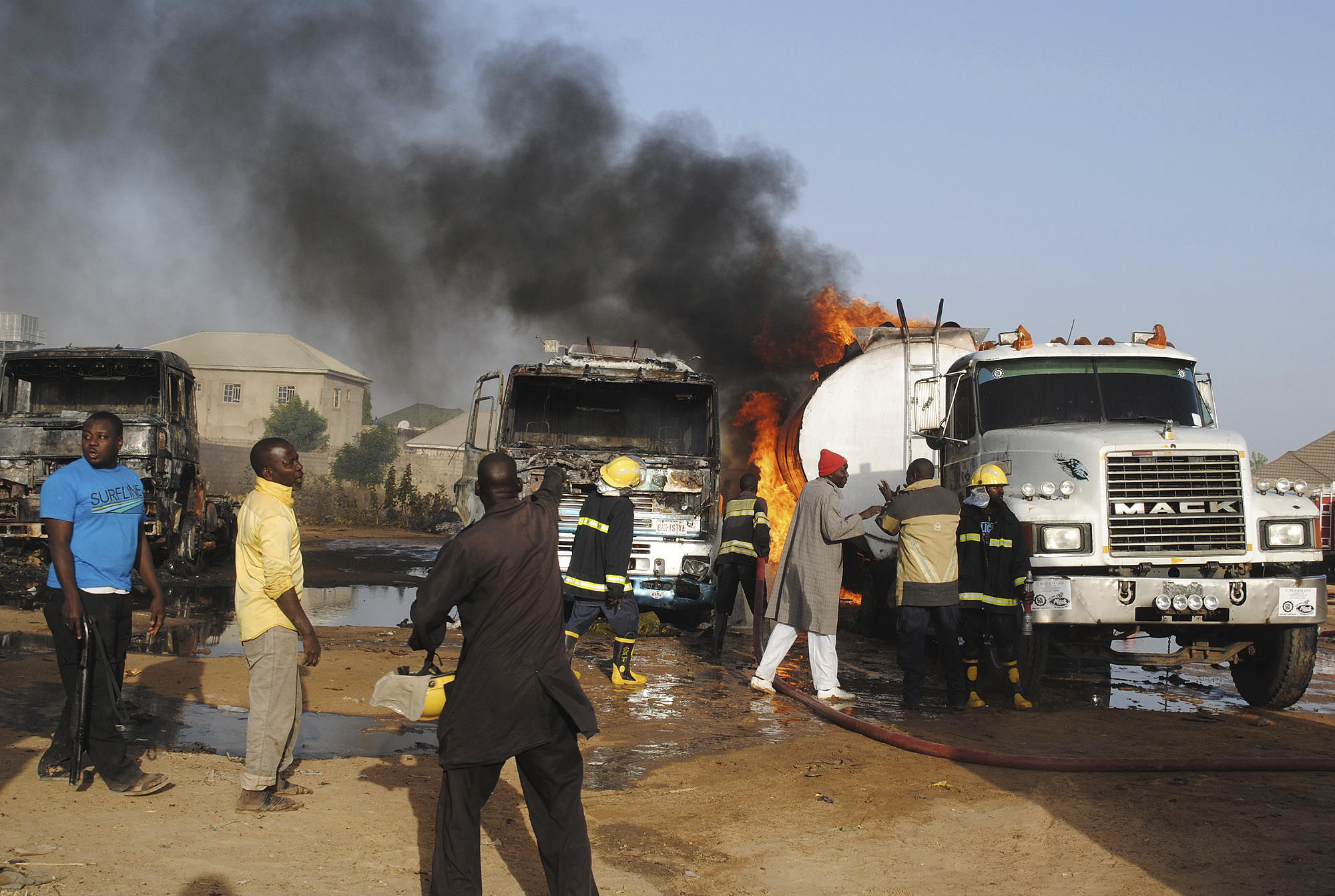 Firefighters try to contain a blaze following a suicide attack on oil tankers in Maiduguri, Nigeria, on March 3. (Jossy Ola / Associated Press)
