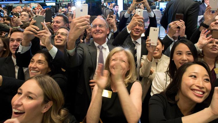 Employees of Snap Inc. and their friends celebrate as the company's co-founders ring the opening bell of the New York Stock Exchange on Thursday.