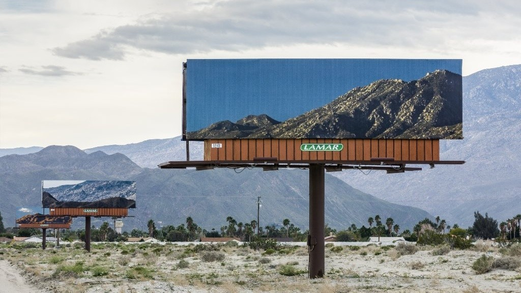 On Gene Autry Trail leading into Palm Springs, Jennifer Bolande posted billboards that picture the mountain view behind them. (Desert X)