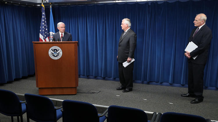 Atty. Gen. Jeff Sessions, left, Secretary of State Rex Tillerson, center, and Homeland Security Secretary John F. Kelly. (Mark Wilson / Getty Images)