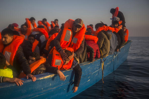 Refugees and migrants on boat from Libya. (Santi Palacios /  Associated Press)