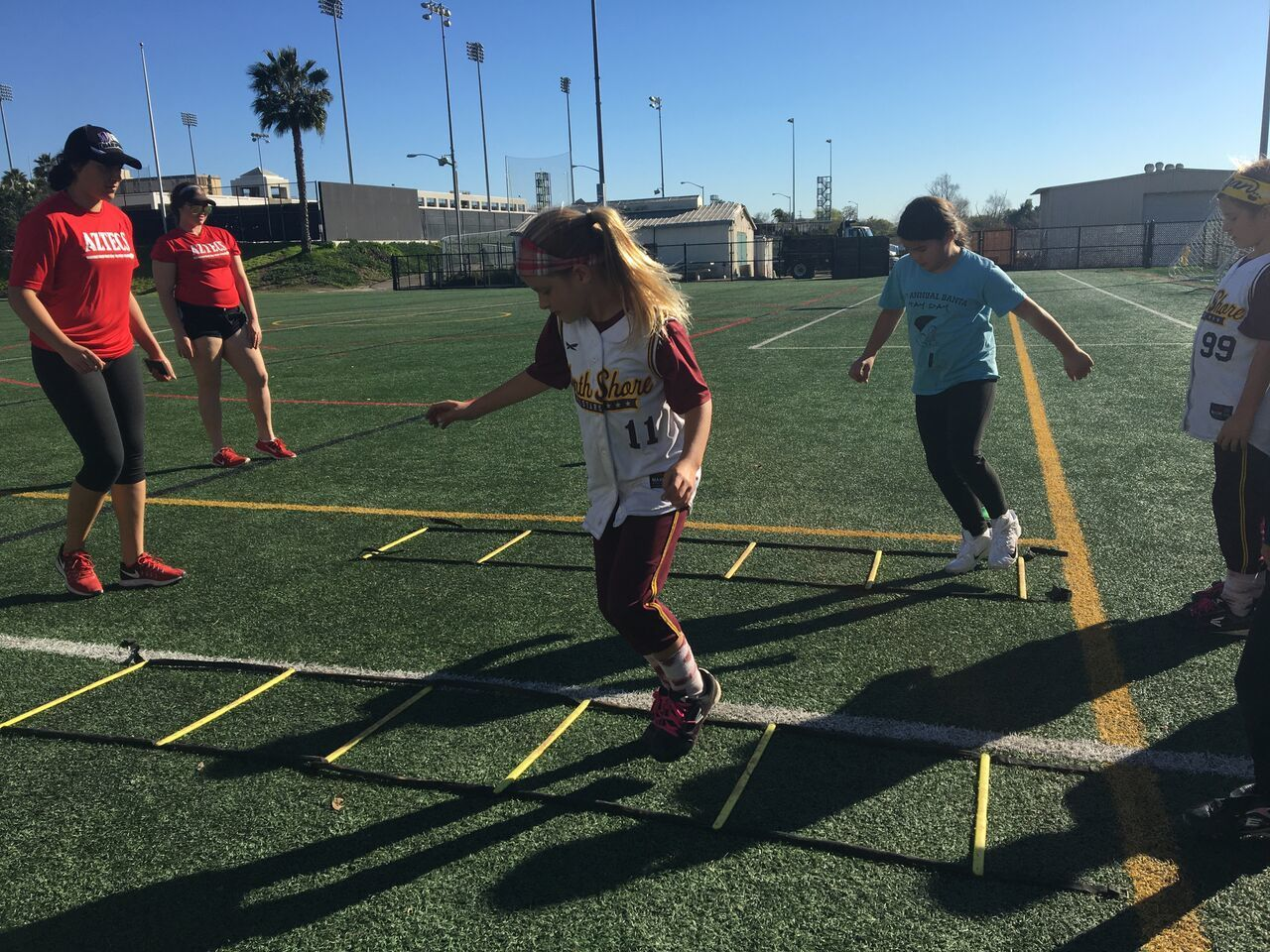 More than 50 girls participated in a variety of drills that were designed to develop and hone softball skill and technique.