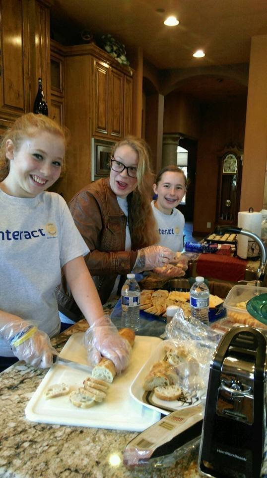 Ramona High Interact Club members Emily Gardnier, Aldebaron Levin, and Eden Anderson help with food preparation.