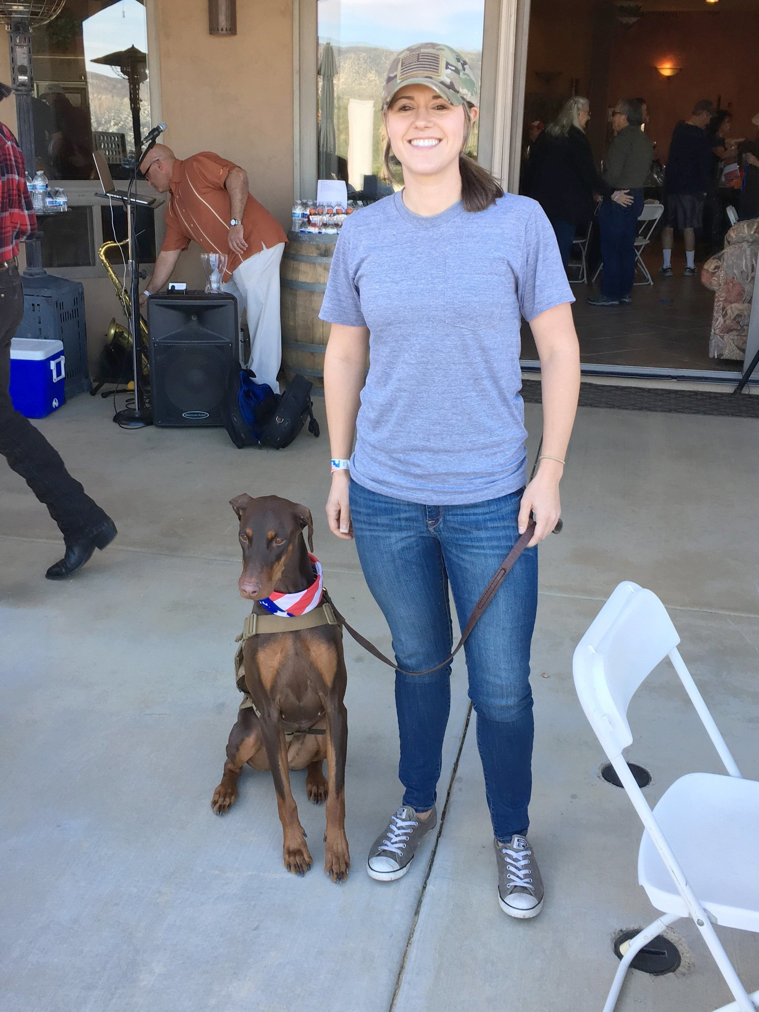 Orange County resident Katie Caffrey, an Army veteran, arrives with Dobby, who has been with her for two years.