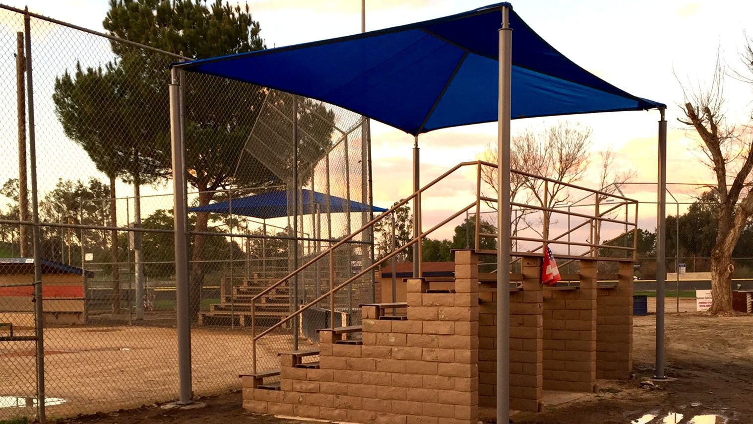 Two shade structures cover stands at a Pony baseball field. A total of six shade structures were added in the baseball complex in Ramona Community Park.
