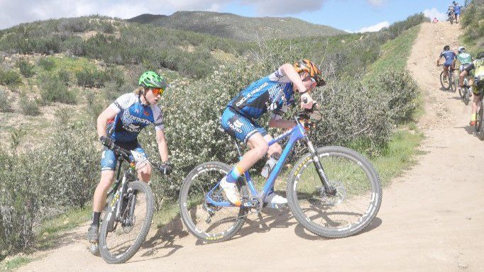 Seth Levy and Karson Basore round a bend during the Cycle Dawgs race at Vail Lake in Temecula.