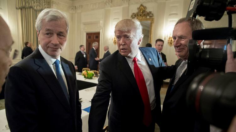 Jamie Dimon left chief executive of JPMorgan Chase & Co. and President Trump appear before a White House forum on Feb. 3