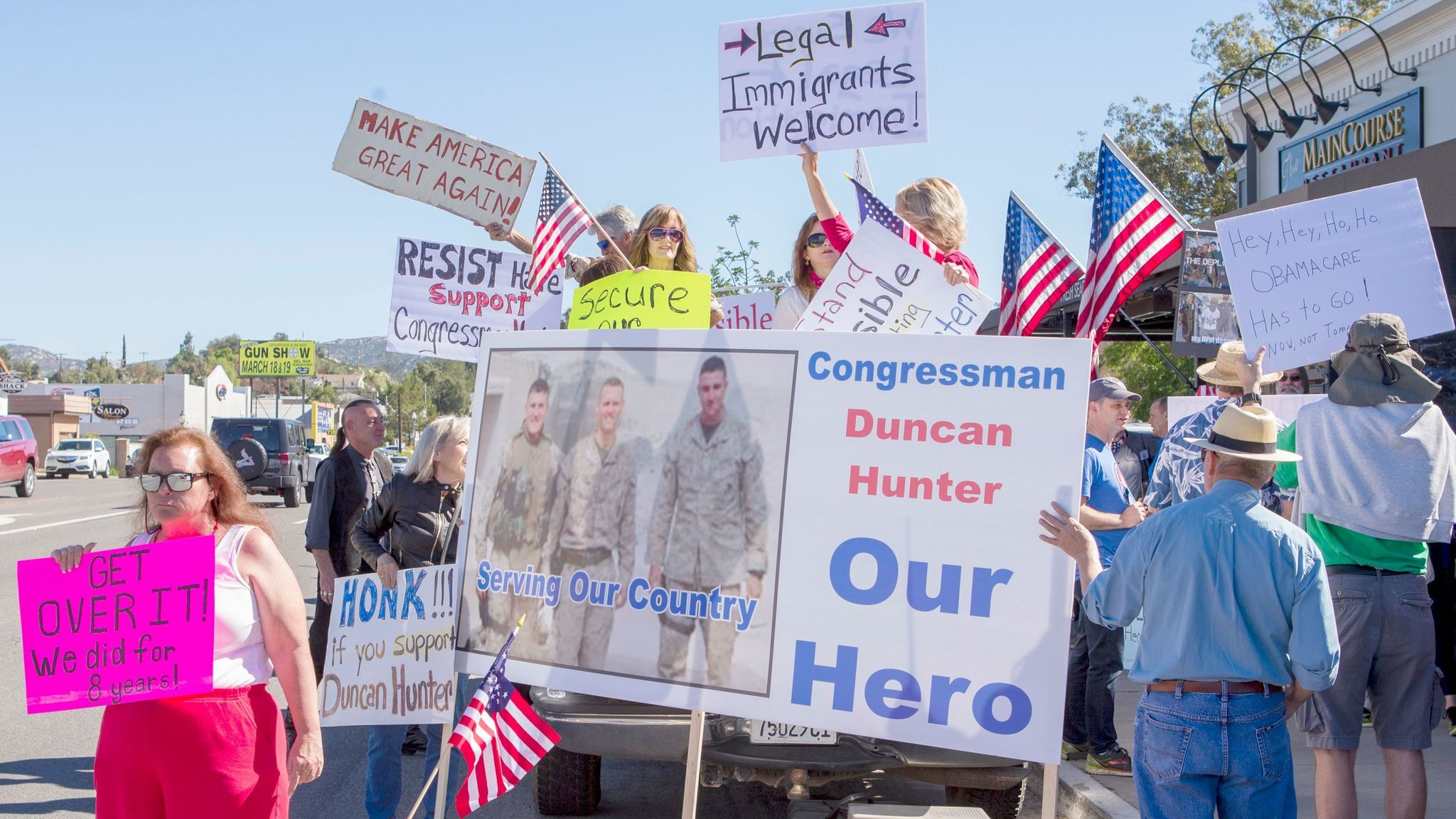 Hunter supporters show their signs in front of Ramona Mainstage.