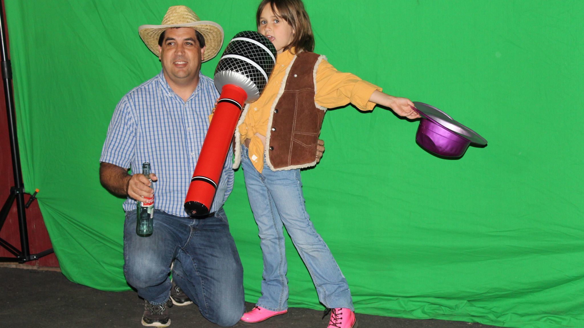 First-grader Jacey Morton poses for a father/daughter photo with her dad, Doug Morton, at the photo booth.
