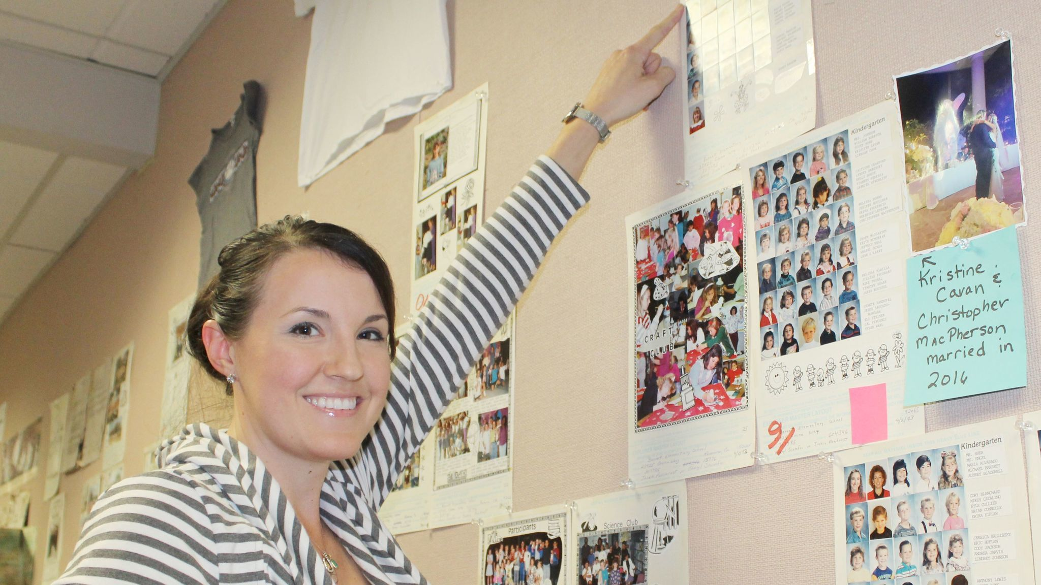 Lindsay Dreyer, a 2005 Ramona High School graduate and 2005 Ramona Rodeo queen, points to her kindergarten photo in the yearbook. Her mother, Shirleen, worked with students in Barnett's before- and after-school ESP program from 1992 -2010.