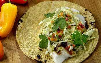 Grilled halibut soft tacos with lime-garlic vinaigrette