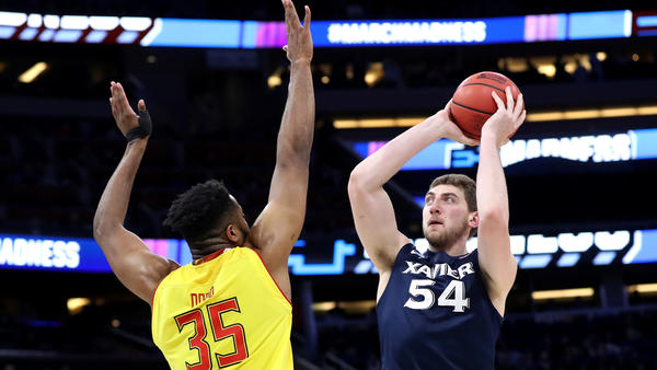 Xavier center Sean O'Mara attemps a shot over Maryland center Damonte Dodd during the first half. (Robb Carr / Getty Images)