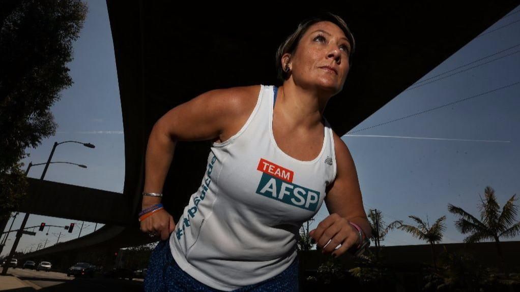 Amy Robinson will run in the L.A. Marathon on Sunday, the eighth marathon in which she's competed in the last three years. Robinson has used running to help combat depression. (Rick Loomis / Los Angeles TImes)