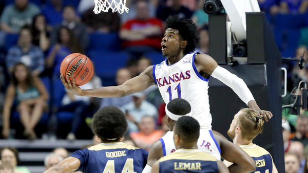 Kansas guard Josh Jackson elevates for a reverse layup against UC Davis during the first half. (Tony Gutierrez / Associated Press)