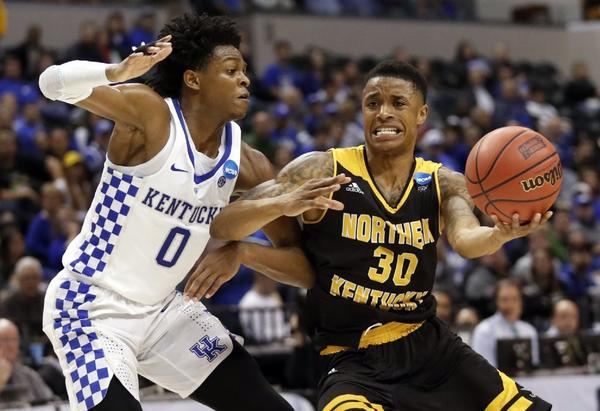 Northern Kentucky's Lavone Holland II heads to the basket past Kentucky's De'Aaron Fox during the second half of an NCAA tournament game on March 18 in Indianapolis. (Jeff Roberson / Associated Press)