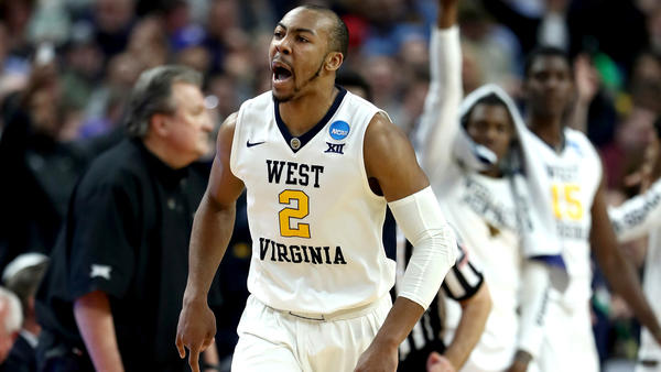 West Virginia guard Jevon Carter reacts after making a three-pointer against Notre Dame. (Elsa / Getty Images)