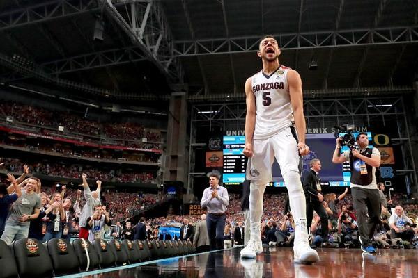 NCAA tournament live updates: Half of Elite Eight is set, with Xavier knocking off Arizona