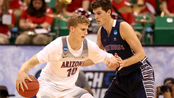 Arizona forward Lauri Markkanen works in the post against St. Mary's center Evan Fitzner during the first half Saturday. (Christian Petersen / Getty Images)