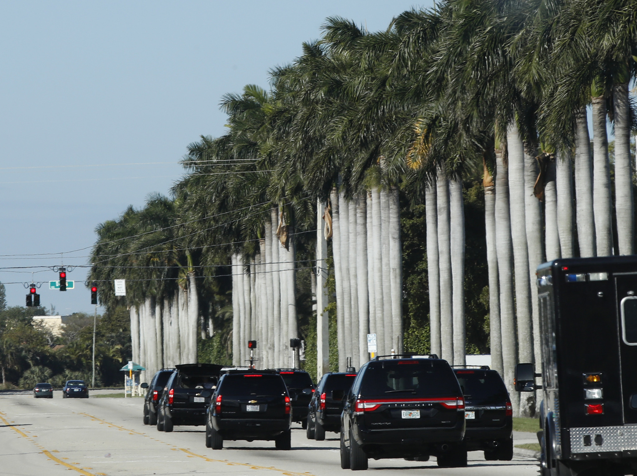 President Trump's motorcade drives in West Palm Beach Fla. toward the Trump International Golf Club on Saturday