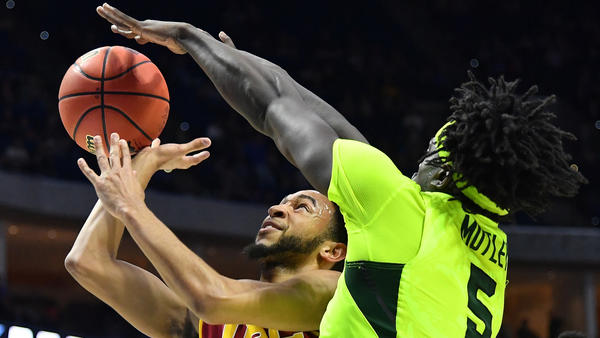 Baylor forward Johnathan Motley tries to block a layup by USC point guard Jordan McLaughlin during the first half Sunday. (J Pat Carter / Getty Images)