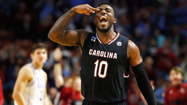 South Carolina guard Duane Notice celebrates after making a three-pointer against Duke during the second half Sunday. (Gregory Shamus / Getty Images)