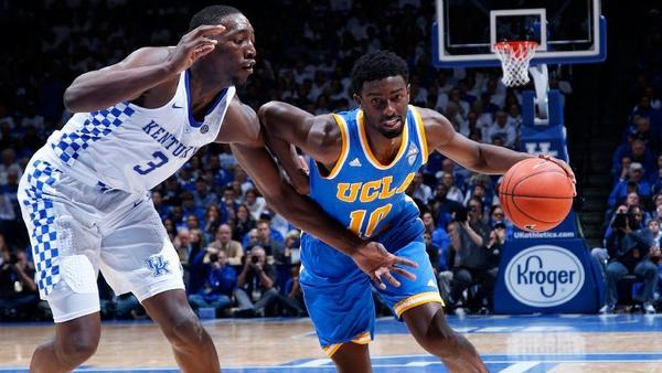 Kentucky center Bam Adebayo (3) tries to cut off a drive by UCLA guard Isaac Hamilton during a game last season. (Joe Robbins / Getty Images)