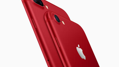 Apple unveils red iPhone, cuts price on iPad as stock hits high