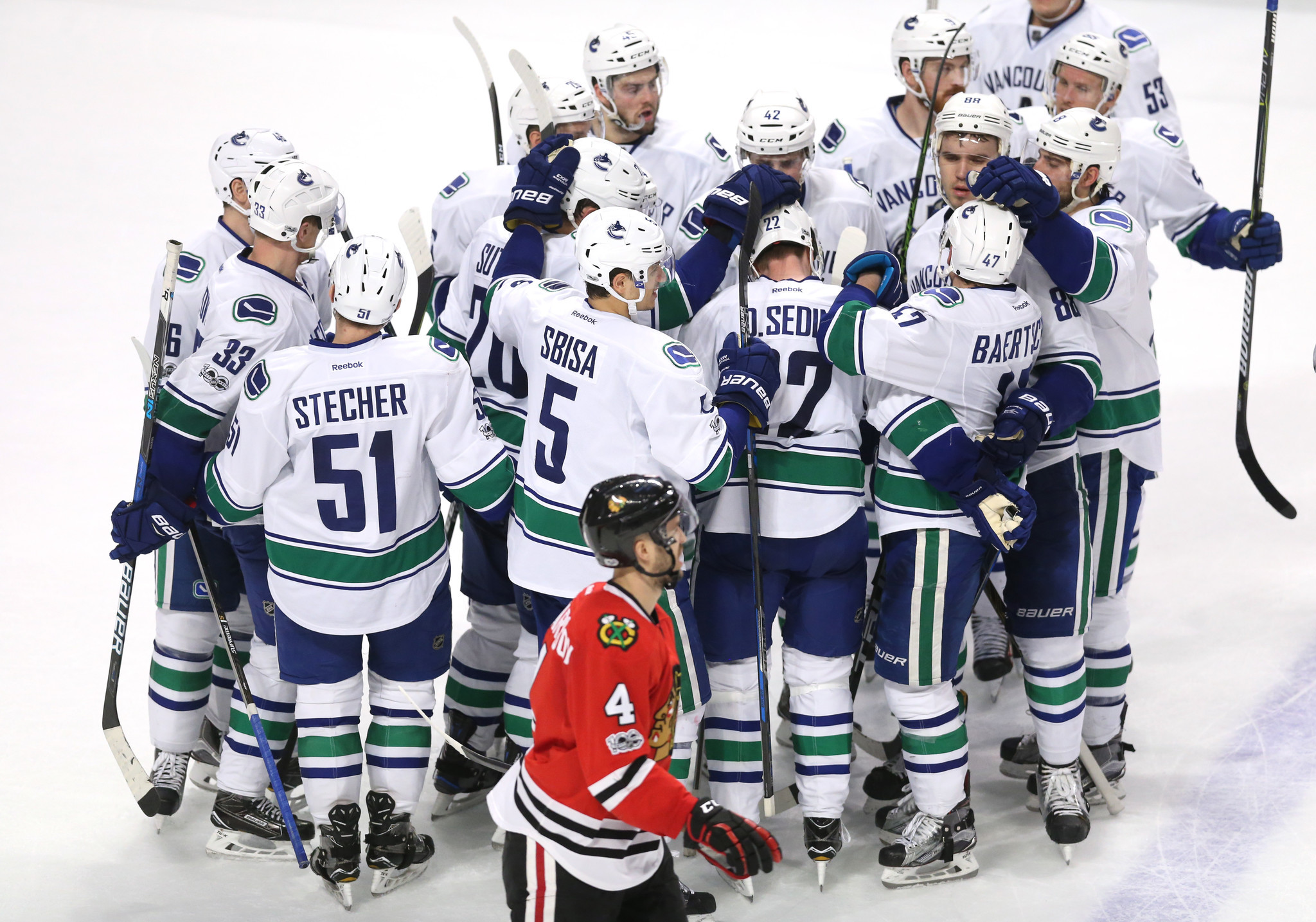 Ct-blackhawks-lose-overtime-canucks-spt-0322-20170321