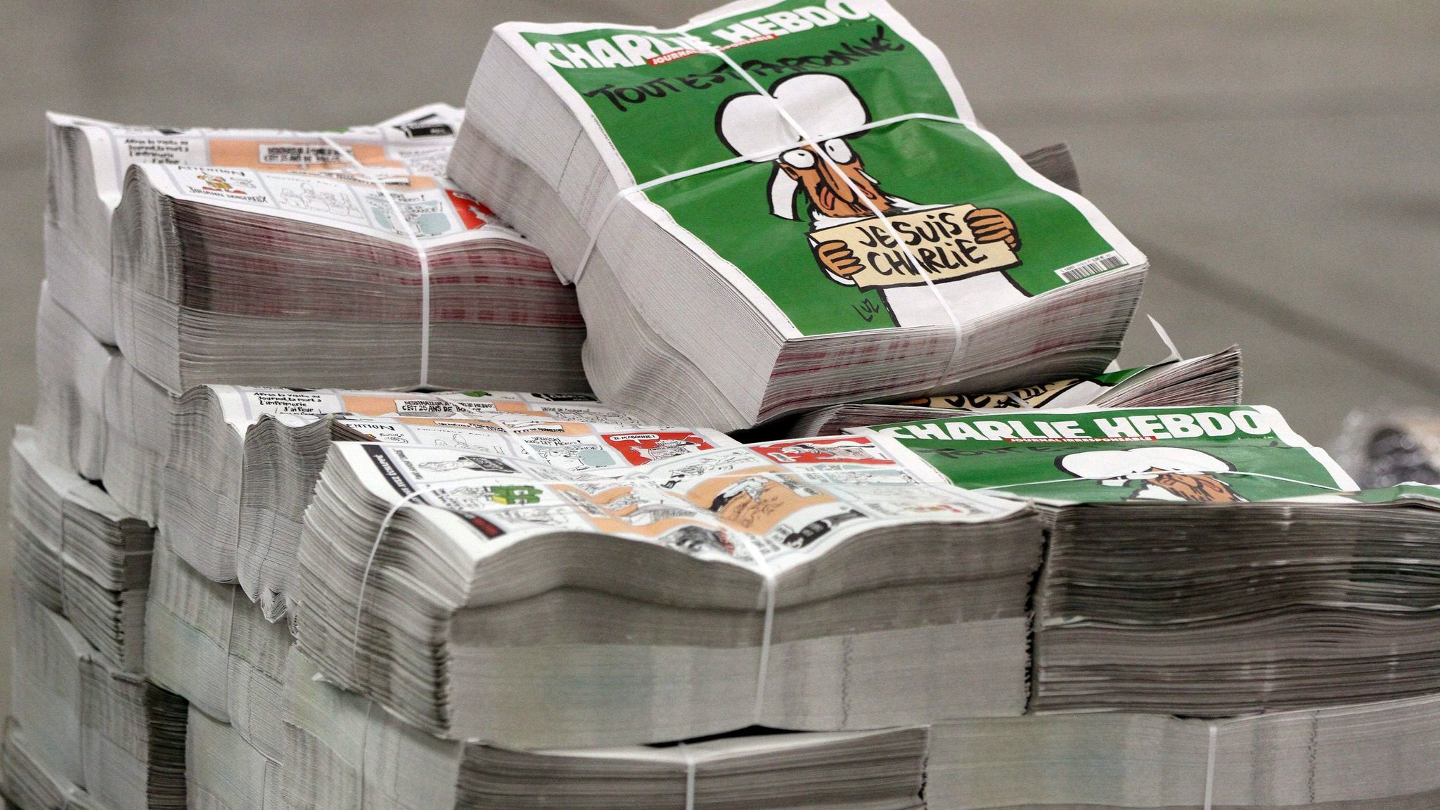 Copies of the French satirical magazine Charlie Hebdo are stacked at a distribution center in Nantes, France, Jan. 13, 2015.