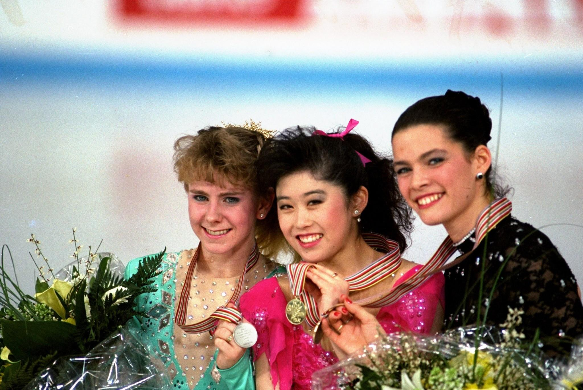 Tonya Harding, left, Kristi Yamaguchi and Nancy Kerrigan after the finals of the 1991 World Figure Skating Championships. (Diether Endlicher / Associated Press)