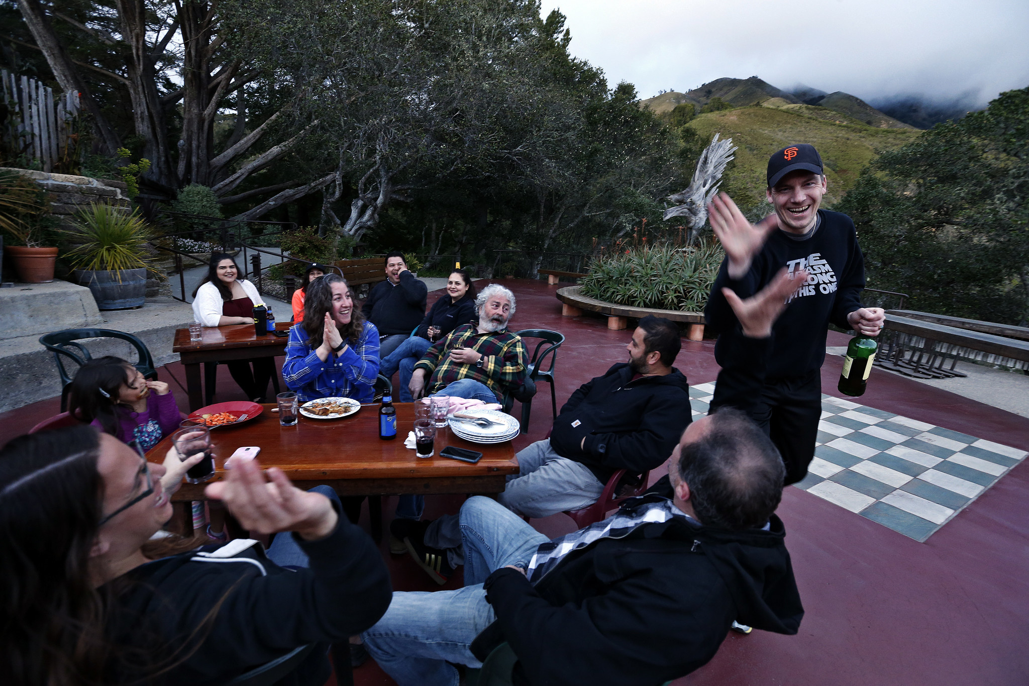 Sander Koning, 39, right, high-fives Adam Olthof during an impromptu barbecue for employees at Nepenthe Restaurant.