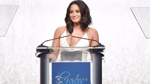 Honoree Demi Lovato gets an award, host Lisa Kudrow serves up the laughs at the Open Mind Gala in Beverly Hills