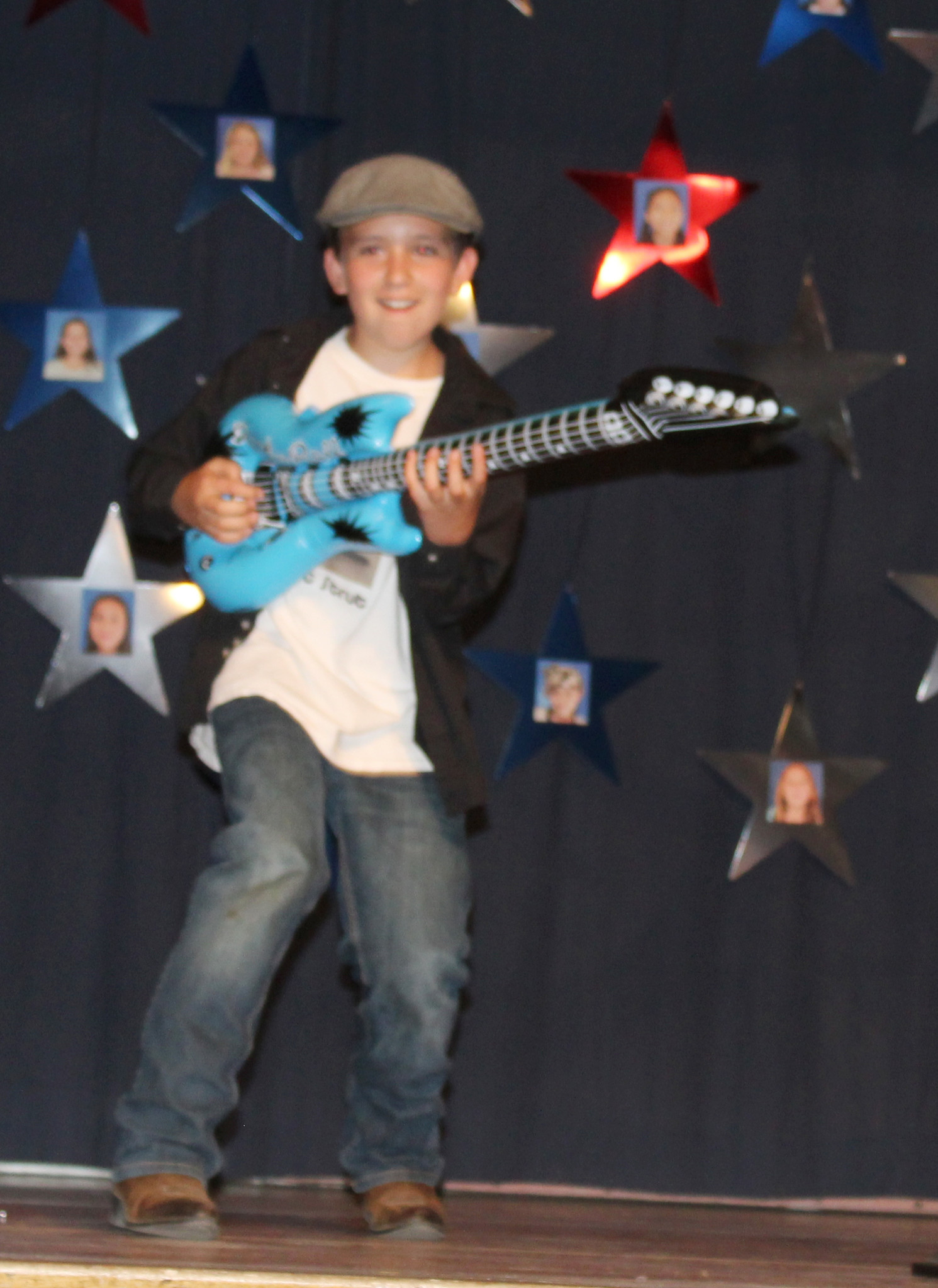 "Fifth-grader Matthew Castillo ""plays"" his blow-up guitar in ""Stray Cat Strut,"" a crowd favorite he presented with brother David, a second-grader."