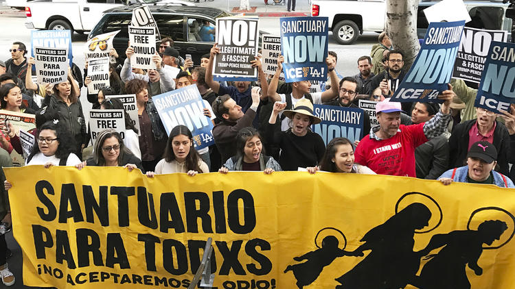 About 100 people demonstrate outside a federal immigration court in Los Angeles. (Michael Balsamo / AP)