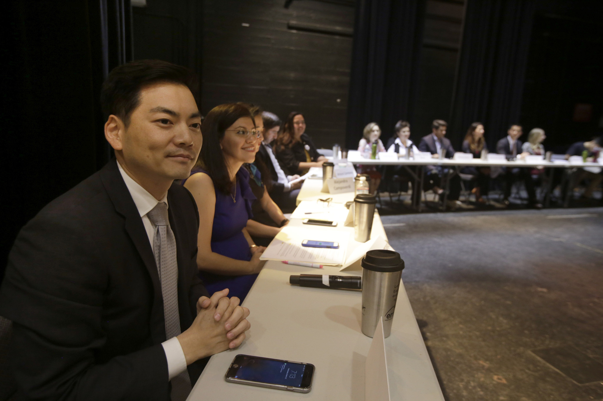 Robert Lee Ahn, left, and Vanessa Aramayo, second from left, join the other candidates  for the 34th Congressional District. (Glenn Koenig / Los Angeles TImes)