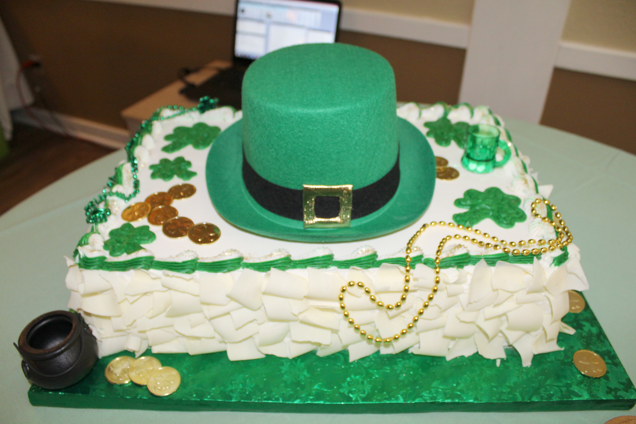 Lucky pennies, gold-colored coins, shamrocks, and a green hat top the evening's dessert.