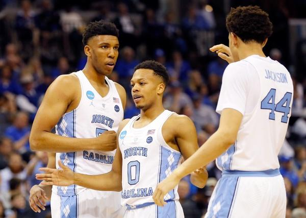 North Carolina's Nate Britt (0) celebrates with his teammates Tony Bradley (5) and Justin Jackson (44) during the second half of a Sweet 16 game against Butler on March 24. (Kevin C. Cox / Getty Images)
