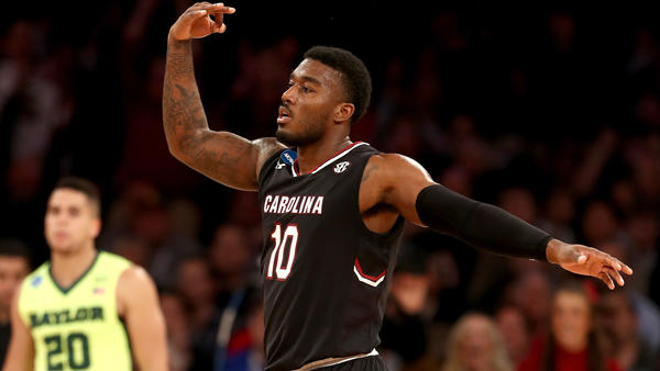 South Carolina guard Duane Notice celebrates after making a three-pointer against Baylor during the second half Friday night. (Elsa / Getty Images)