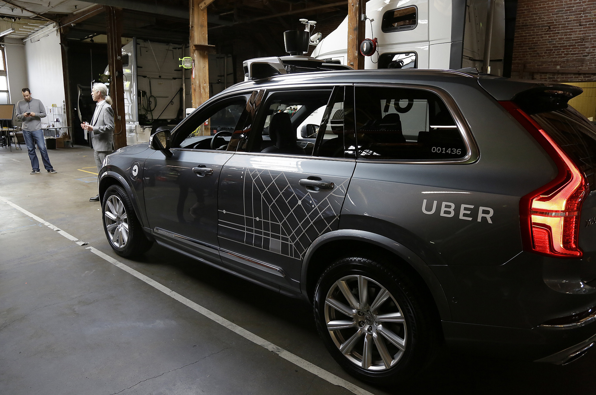 Uber suspends its self-driving car tests after one of its SUVs was struck in Arizona