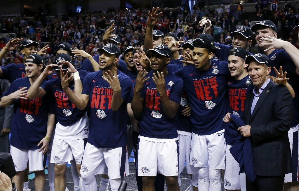 Gonzaga players celebrate after beating Xavier, 83-59, to advance to the Final Four of the NCAA tournament on March 25. (Tony Avelar / Associated Press)