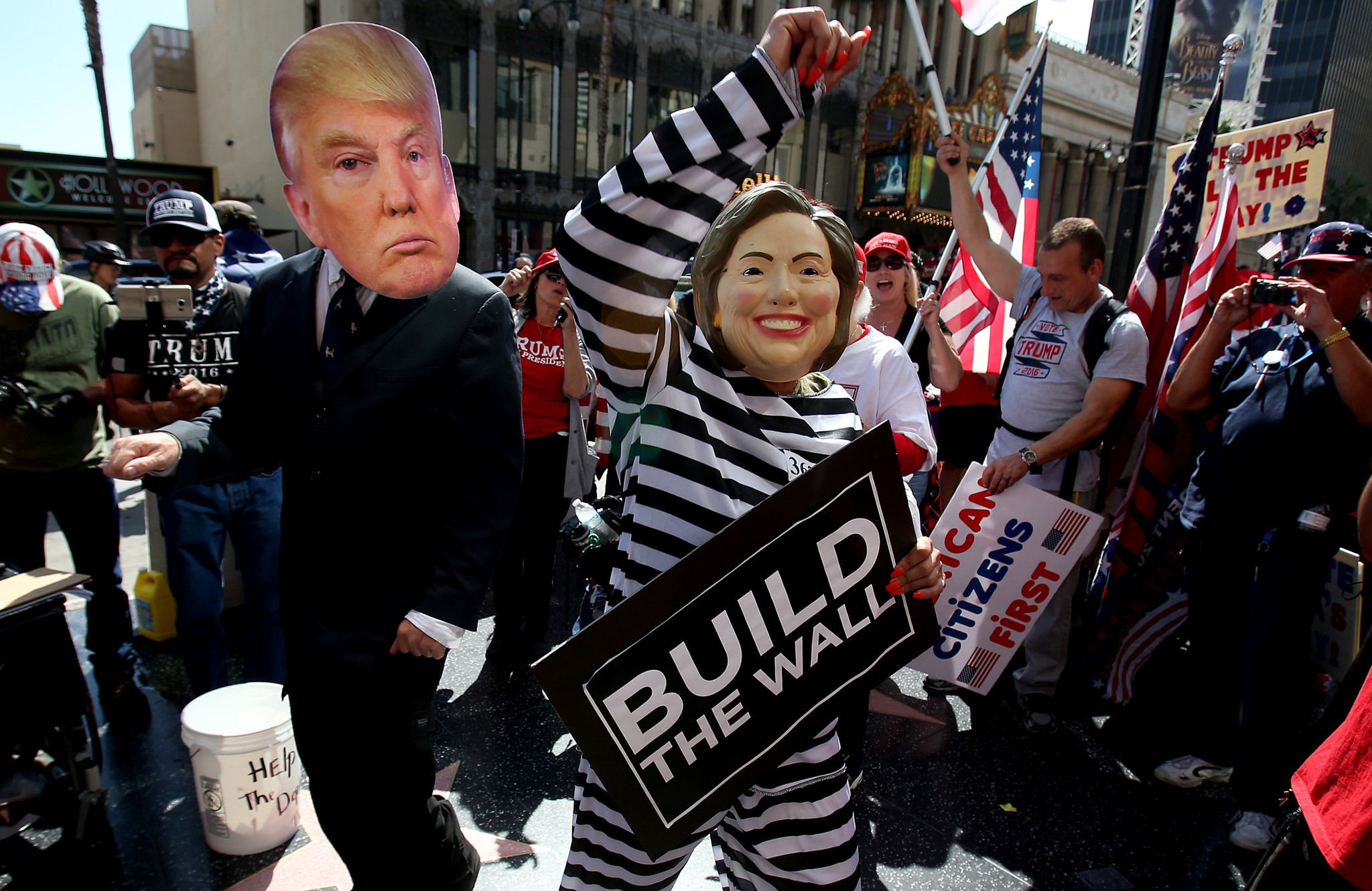 Supporters of President Donald Trump dance on the Walk of Fame during a rally along Hollywood Boulevard on Saturday, March 25. (Luis Sinco / Los Angeles Times)
